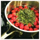 steeping tea and raspberries in syrup