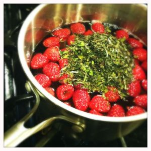 steeping tea and raspberries in syrup