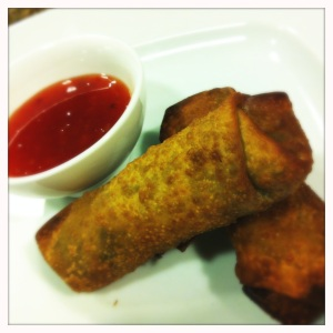 serving tea mushroom egg rolls with sweet chile sauce