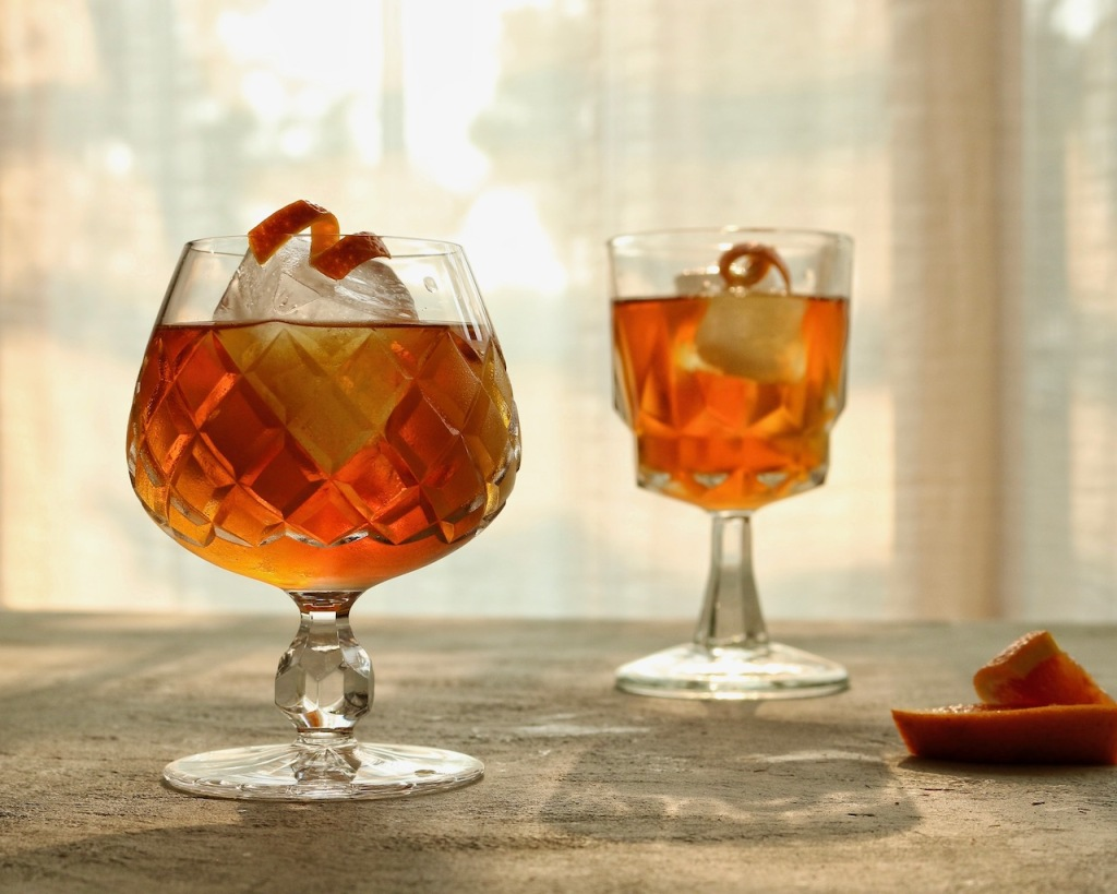 orange garnish on tea infused cocktails